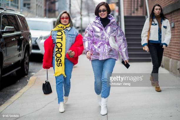 Guest wearing yellow scarf, metallic puffer jacket, cropped denim jeans seen outside Self-Portrait on February 10, 2018 in New York City.