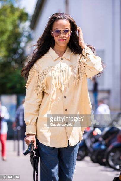 Guest wearing yellow shirt and Carrera sunglasses is seen in the streets of Paris after the JuunJ show during Paris Men's Fashion Week Spring/Summer...