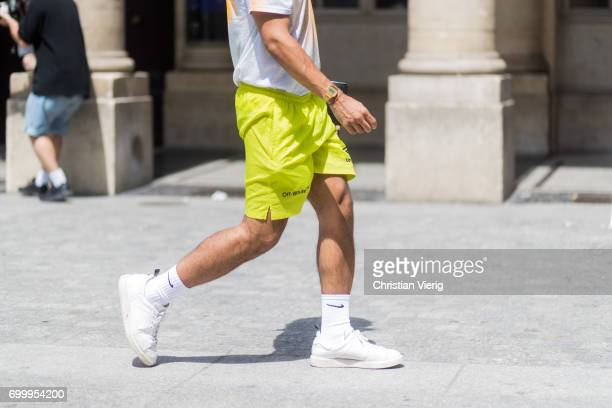 A guest wearing yellow shorts Nike socks sneakers outside Louis Vuitton during Paris Fashion Week Menswear Spring/Summer 2018 on June 22 2017 in...