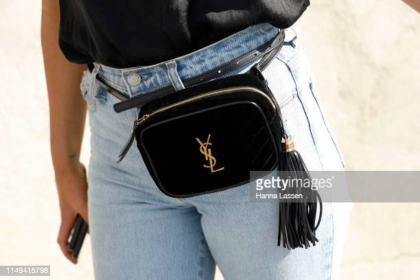 A guest wearing Yves Saint Laurent belt bag at MercedesBenz Fashion Week Resort 20 Collections on May 16 2019 in Sydney Australia