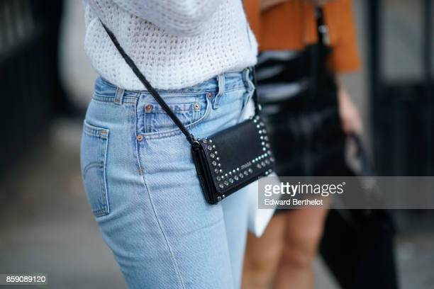 A guest wears a bag outside Kaviar Gauche during Paris Fashion Week Womenswear Spring/Summer 2018 on September 29 2017 in Paris France