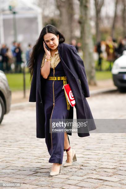 A guest wears a balck coat a striped shirt a yellow OffWhite belt shoes outside Beautiful People during Paris Fashion Week Womenswear Fall/Winter...