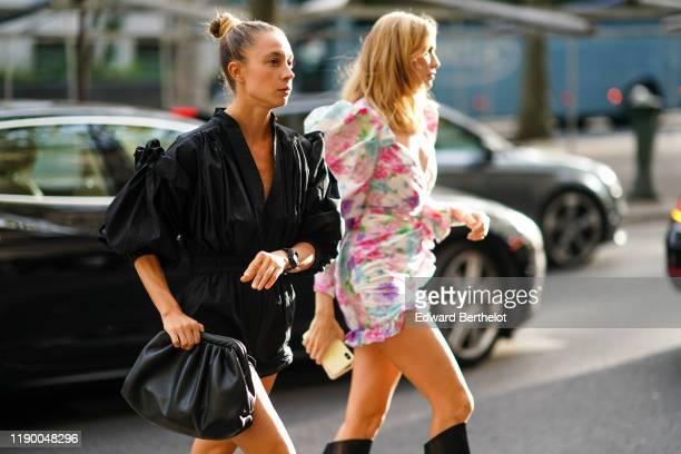 Guest wears a balck ruffle dress, a black puff bag, a watch, outside Alessandra Rich, during Paris Fashion Week - Womenswear Spring Summer 2020, on...