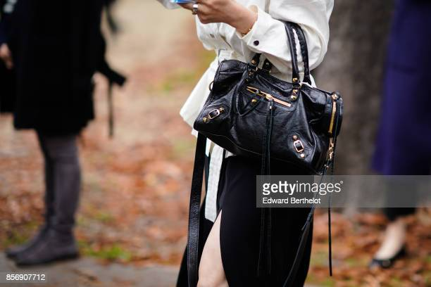 Guest wears a Balenciaga bag, outside Leonard, during Paris Fashion Week Womenswear Spring/Summer 2018, on October 2, 2017 in Paris, France.