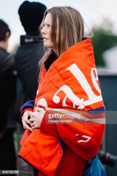 A guest wears a Balenciaga oversized puffer coat outside Versus during London Fashion Week September 2017 on September 17 2017 in London England