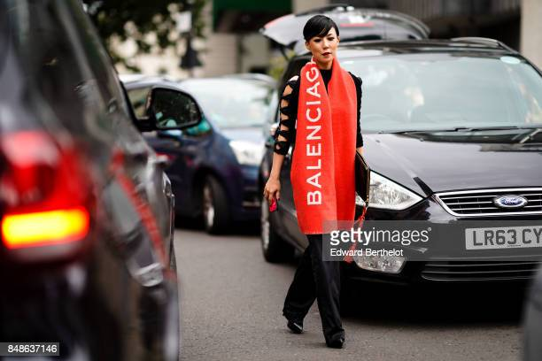A guest wears a Balenciaga scarf outside Preen by Thornton Bregazzi during London Fashion Week September 2017 on September 17 2017 in London England