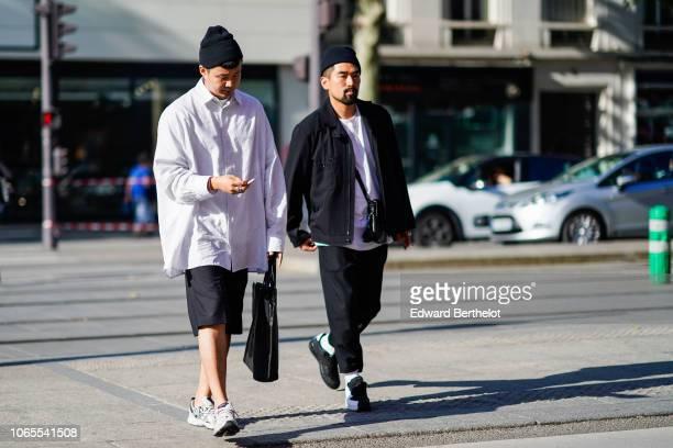A guest wears a beanie hat an oversized shirt a short sneakers outside Dries Van Noten during Paris Fashion Week Menswear SpringSummer 2019 on June...