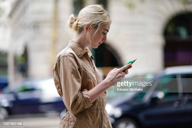 A guest wears a beige outfit during London Fashion Week September 2018 on September 14 2018 in London England