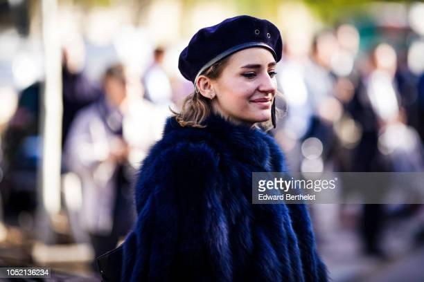 A guest wears a beret a blue fur coat outside Haider Ackermann during Paris Fashion Week Womenswear Spring/Summer 2019 on September 29 2018 in Paris...