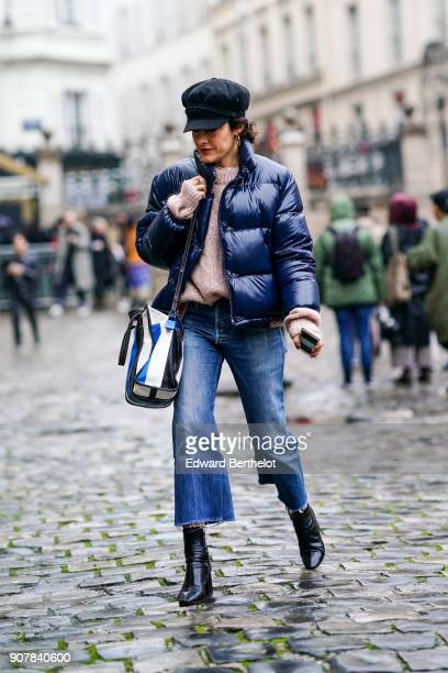 A guest wears a beret hat a blue puffer coat cropped jeans outside Thom Browne during Paris Fashion Week Menswear Fall Winter 20182019 on January 20...