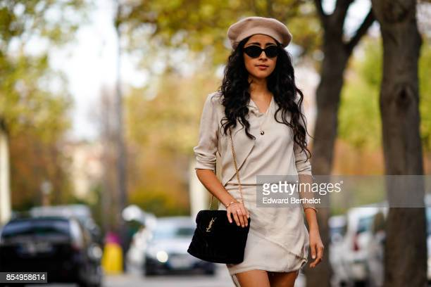 A guest wears a beret hat a skirt thigh high boots outside the Rochas show during Paris Fashion Week Womenswear Spring/Summer 2018 on September 27...
