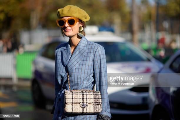 A guest wears a beret sunglasses a tartan chanel bag a blue tartan suit blazer jacket outside Chanel during Paris Fashion Week Womenswear...