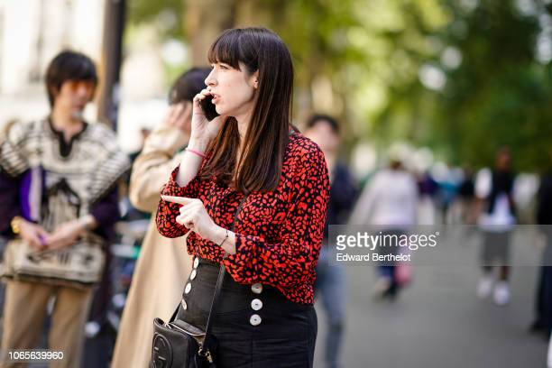 A guest wears a black and red shirt outside Issey Miyake during Paris Fashion Week Menswear SpringSummer 2019 on June 21 2018 in Paris France