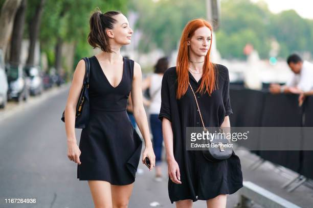 A guest wears a black bag a black minidress with a deep cleavage A guest wears a black bag necklaces a black flowing minidress outside the Kerastase...
