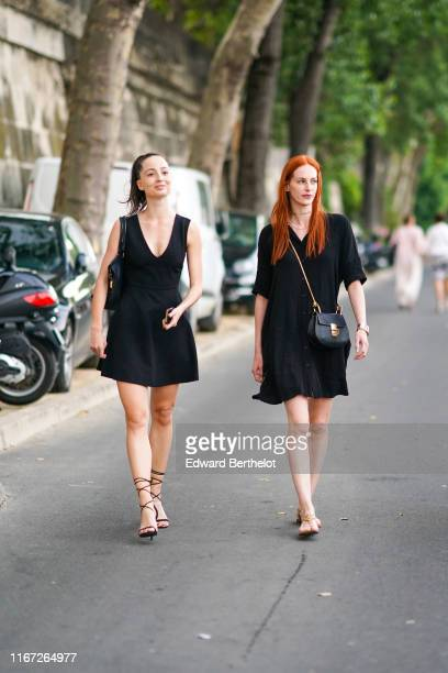 A guest wears a black bag a black minidress with a deep cleavage black gladiator sandals A guest wears a black bag necklaces a black flowing dress...