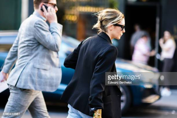 A guest wears a black blazer jacket sunglasses outside Valentino during Paris Fashion Week Haute Couture Fall/Winter 2019/2020 on July 03 2019 in...