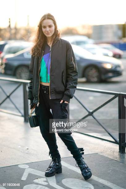 A guest wears a black bomber jacket a colored top black pants boots outside Proenza Schouler during Paris Fashion Week Haute Couture Spring/Summer...