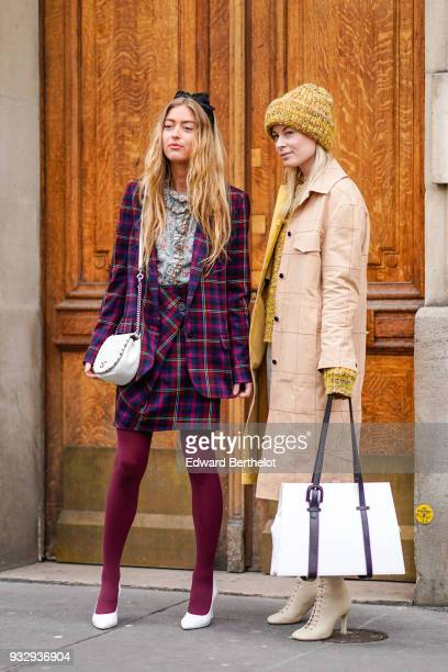 A guest wears a black bow headband a marled grey ruffle collar top a purple plaid suit with a wrap skirt purple tights white pumps a white...