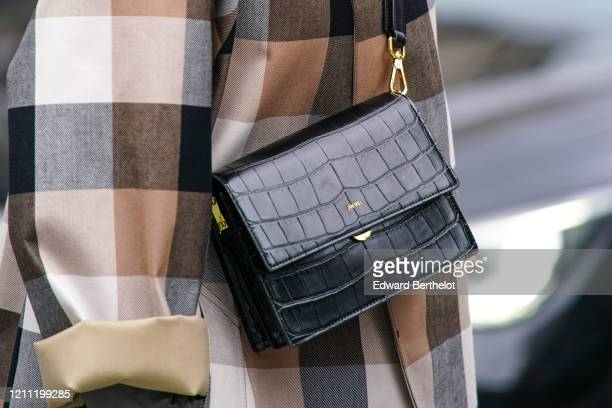 Guest wears a black, brown and beige checkered trench coat, a black crocodile pattern JW Pei crossbody bag, outside Giambattista Valli, during Paris...