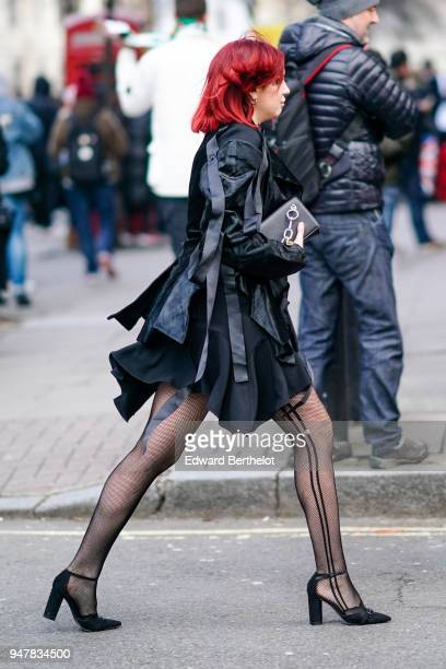 A guest wears a black dress tights black shoes during London Fashion Week Men's January 2018 at on January 6 2018 in London England