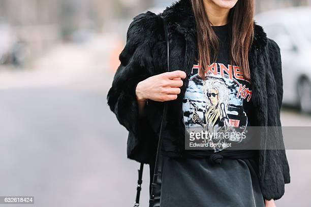 Laura Bichard wears a black fur coat a Chanel tshirt with a logo inspired by the Iron Maiden rock band album 'Killers' a black skirt black pants a...