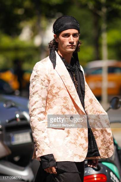 A guest wears a black hair band a black net scarf a peachcolor brocade jacket during Paris Fashion Week Menswear Spring/Summer 2020 on June 21 2019...