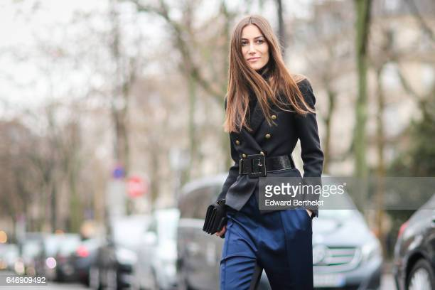 A guest wears a black jacket a belt and blue pants outside the Rochas show during Paris Fashion Week Womenswear Fall/Winter 2017/2018 on March 1 2017...