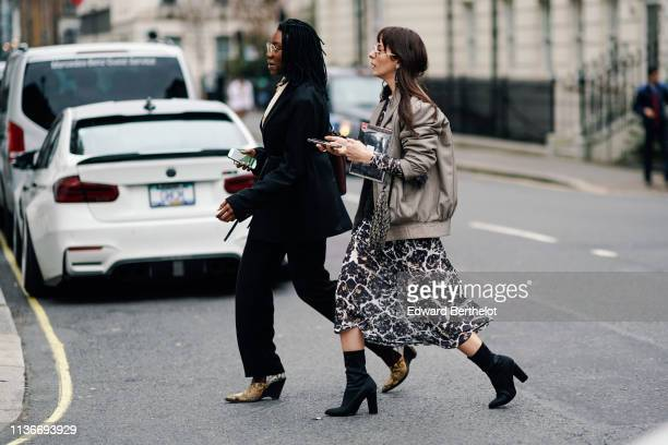 Guest wears a black jacket, black pants, pointy brown and grey python pattern shoes ; A guest wears a grey leather jacket, a printed white and brown...