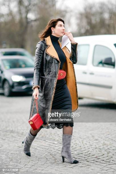 A guest wears a black leather coat with brown inner lining a red rectangular bag a Gucci belt bag a turtleneck black top a black lace skirt gray...