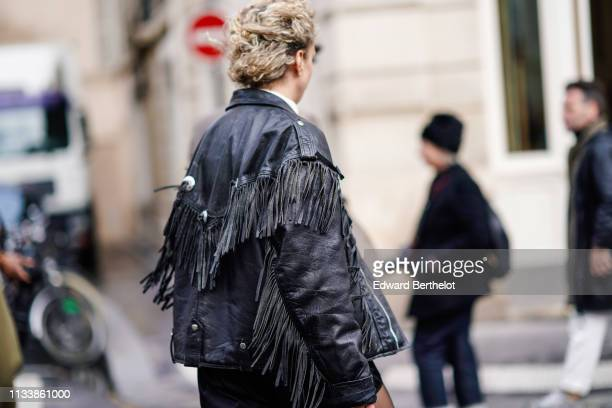 A guest wears a black leather fringe outside APC during Paris Fashion Week Womenswear Fall/Winter 2019/2020 on March 04 2019 in Paris France