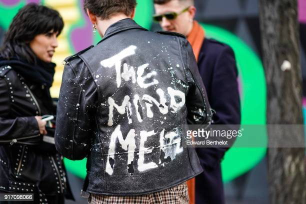 A guest wears a black leather jacket during London Fashion Week Men's January 2018 at on January 6 2018 in London England