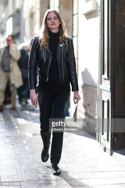 A guest wears a black leather perfecto jacket outside the AALTO show during Paris Fashion Week Womenswear Fall/Winter 2017/2018 on February 28 2017...