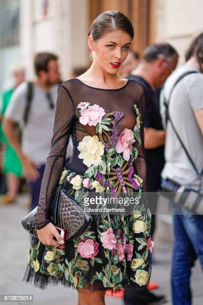 A guest wears a black mesh top with embroidered flowers outside the Jean Paul Gaultier show during Paris Fashion Week Haute Couture Fall/Winter...