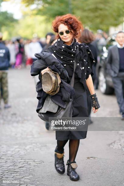 A guest wears a black outfit with white dots outside CDG Comme des Garcons during Paris Fashion Week Womenswear Spring/Summer 2018 on September 30...