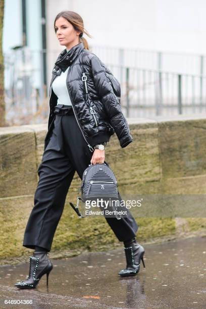 A guest wears a black puffer coat outside the Rochas show during Paris Fashion Week Womenswear Fall/Winter 2017/2018 on March 1 2017 in Paris France