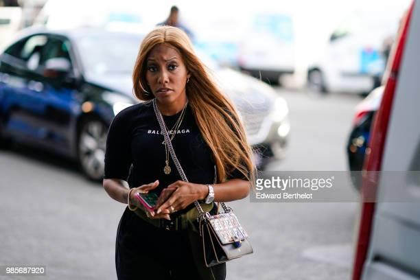 A guest wears a black top a black skirt outside 1017 ALYX 9SM during Paris Fashion Week Menswear SpringSummer 2019 on June 24 2018 in Paris France