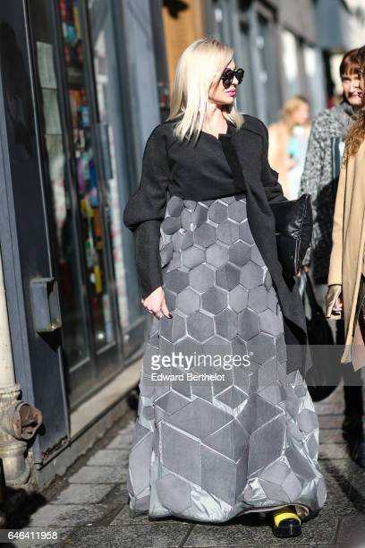 A guest wears a black top and a large gray skirt outside the AALTO show during Paris Fashion Week Womenswear Fall/Winter 2017/2018 on February 28...