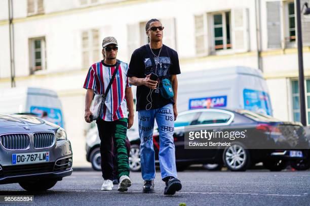 A guest wears a black tshirt blue jeans outside 1017 ALYX 9SM during Paris Fashion Week Menswear SpringSummer 2019 on June 24 2018 in Paris France