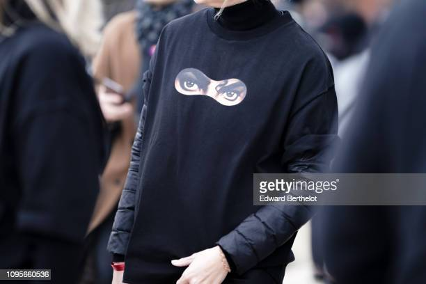 "Guest wears a black t-shirt with a patch depicting the eyes of Michael Jackson from the album ""Dangerous"", outside Louis Vuitton, during Paris..."