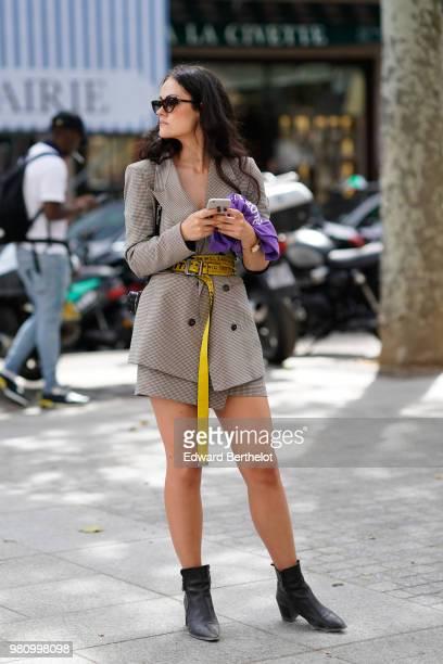 A guest wears a blazer jacket dress with a yellow offwhite belt outside Louis Vuitton during Paris Fashion Week Menswear SpringSummer 2019 on June 21...