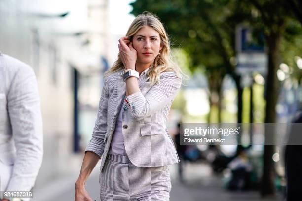A guest wears a blazer jacket outside 1017 ALYX 9SM during Paris Fashion Week Menswear SpringSummer 2019 on June 24 2018 in Paris France