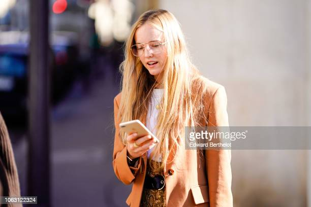 A guest wears a blazer jacket outside Chloe during Paris Fashion Week Womenswear Spring/Summer 2019 on September 27 2018 in Paris France