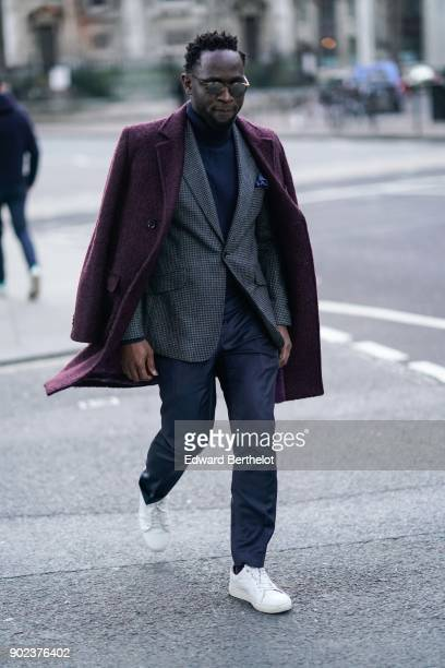 A guest wears a blazer jacket white sneakers during London Fashion Week Men's January 2018 at on January 7 2018 in London England