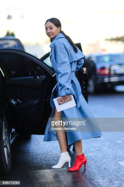 A guest wears a blue coat a white shoe and a red shoe outside the Olivier Theyskens show during Paris Fashion Week Womenswear Fall/Winter 2017/2018...