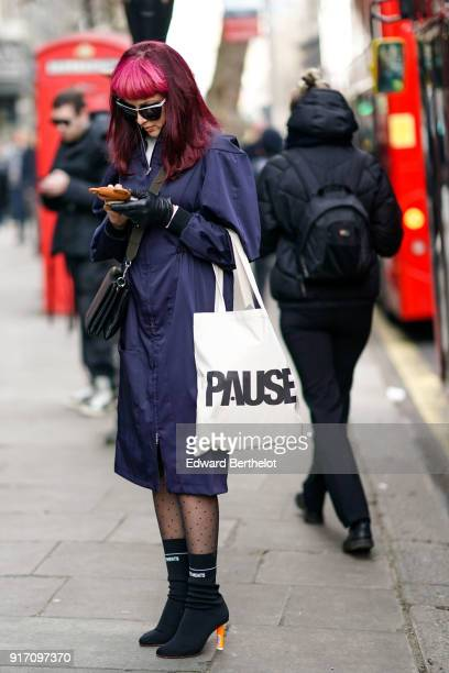 A guest wears a blue coat during London Fashion Week Men's January 2018 at on January 6 2018 in London England