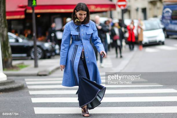 A guest wears a blue coat outside the Moncler show during Paris Fashion Week Womenswear Fall/Winter 2017/2018 on March 7 2017 in Paris France