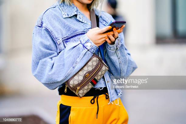A guest wears a blue denim jacket a Gucci bag outside Shiatzy Chen during Paris Fashion Week Womenswear Spring/Summer 2019 on October 1 2018 in Paris...