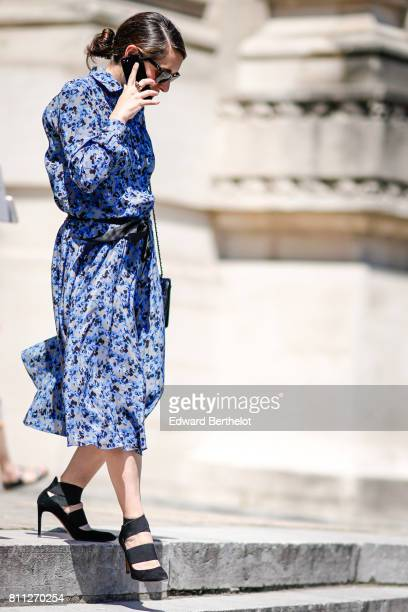 A guest wears a blue floral print dress and black shoes outside the Chanel show during Paris Fashion Week Haute Couture Fall/Winter 20172018 on July...