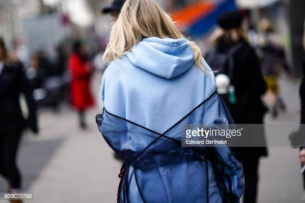 A guest wears a blue hoodie sweater during Paris Fashion Week Womenswear Fall/Winter 2018/2019 on March 3 2018 in Paris France
