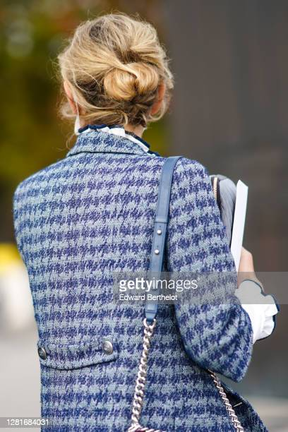 Guest wears a blue houndstooth pattern coat, outside Chanel, during Paris Fashion Week - Womenswear Spring Summer 2021, on October 06, 2020 in Paris,...